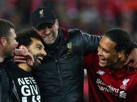 Jurgen Klopp with Mo Salah and Virgil Van Dijk. GOAL