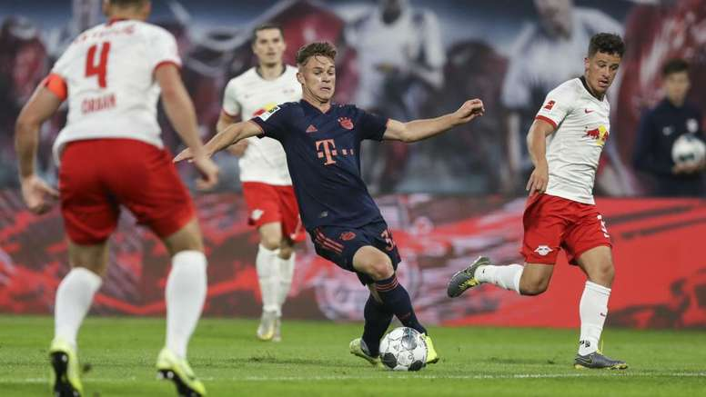 Challengers aim to keep pace with in-form champions in Bundesliga title race. GOAL