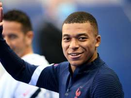 Kylian Mbappe arrives to attend a training session. GOAL