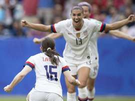USA return home with Women's World Cup trophy, and champagne, in hand