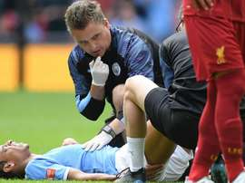 Sane off injured in first half of Community Shield. GOAL