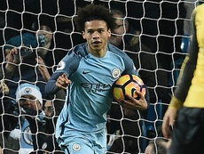 Leroy Sane celebrates scoring his first goal for Manchester City. Goal
