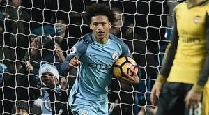 Leroy Sane celebrates scoring his first goal for Manchester City. Goal