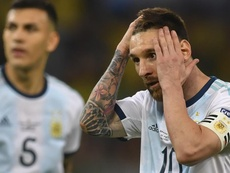 A eterna acusação da falta de entrega de Messi à Seleção. AFP