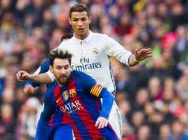 Lionel Messi du Barcelona et Cristiano Ronaldo, du Real Madrid dans un match de La Liga. AFP