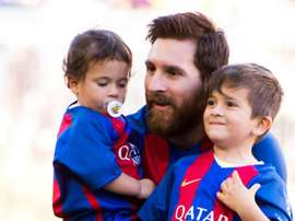 Thiago (right) is the eldest of Messi's children, and takes a keen interest football. GOAL