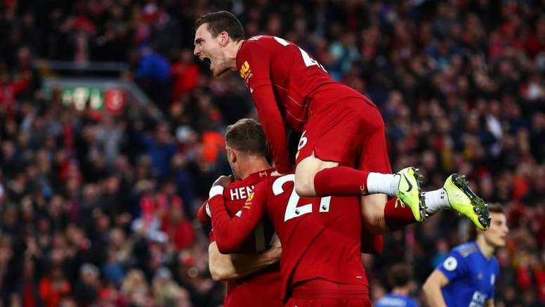 Rooney backing Liverpool for title. GOAL