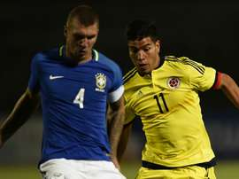Lyanco (left) in action with Brazil's under-20 national team. Goal