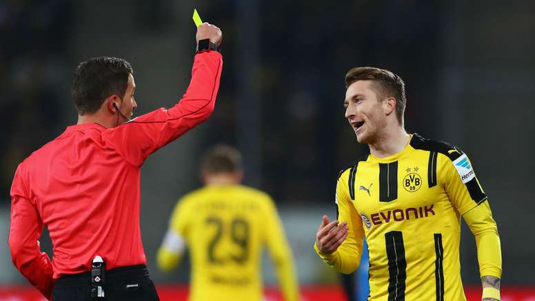 Marco Reus pickis up a yellow card. Goal