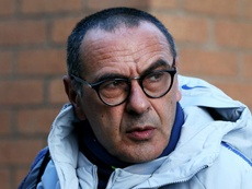 Sarri remains unsure whether Chelsea are serious contenders for the Premier League title . GOAL