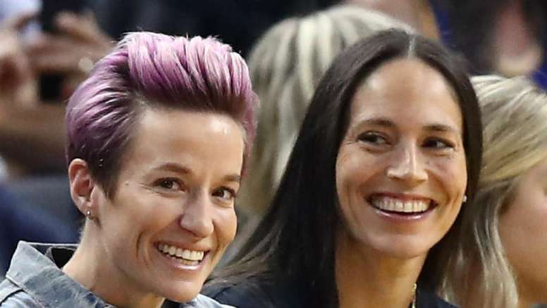 USA World Cup winner Megan Rapinoe (L) has got engaged. GOAL