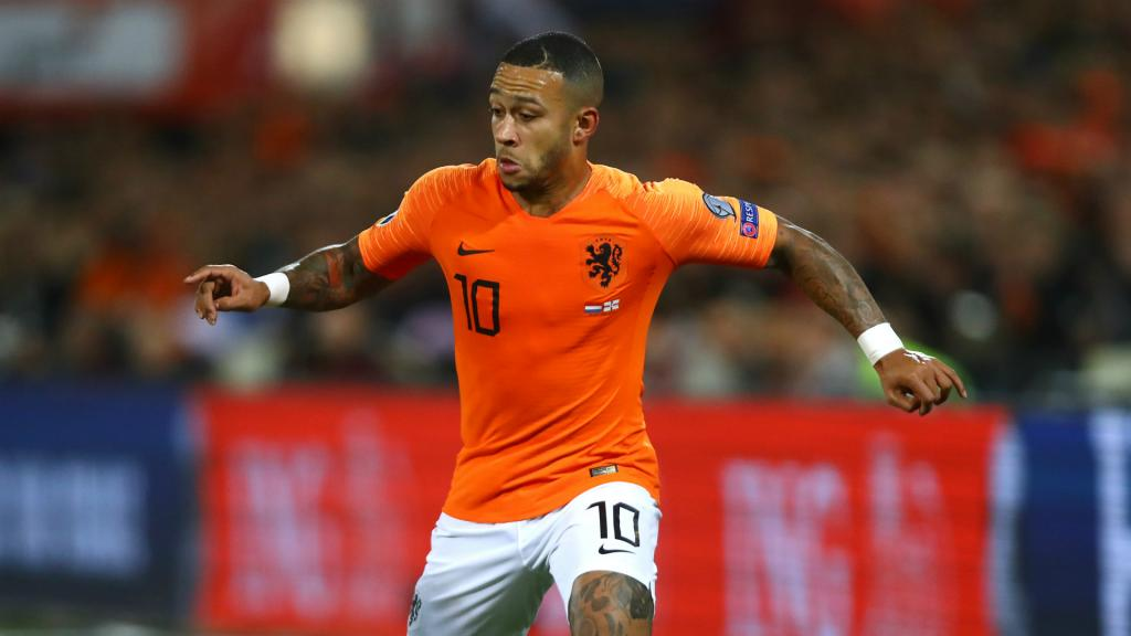 Holland coach Koeman urges Spurs target Memphis to shoot higher than Lyon
