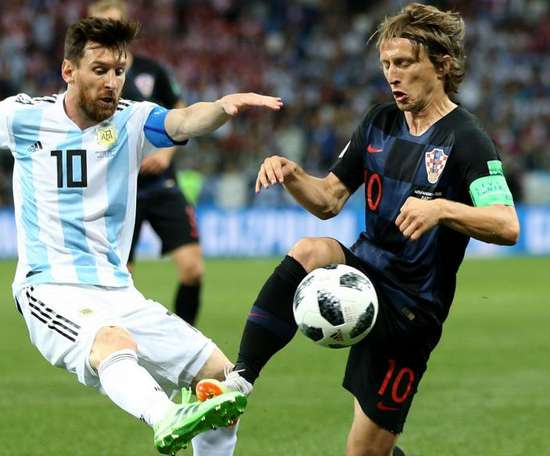 Modric beat Messi to the prize. GOAL