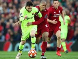 Fabinho attempting to stop Lionel Messi. GOAL