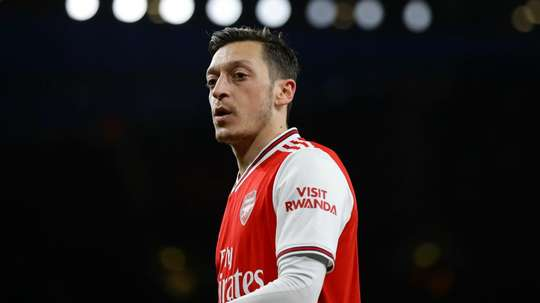 Mesut Ozil will miss Arsenal's Europa League match at Olympiakos. GOAL