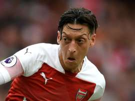 Ozil has had a tough summer. GOAL