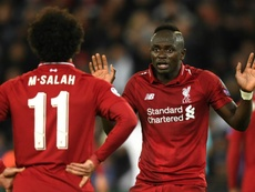 Salah is back in the side for Liverpool's game with Bournemouth while Mane drops to the bench. GOAL