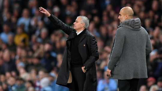 Mourinho and Guardiola pictured at the Manchester Derby. GOAL