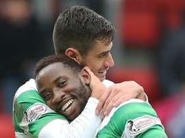 Moussa Dembele celebrating his hat-trick. Goal