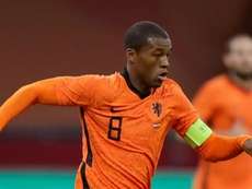 Wijnaldum has mixed emotions after captaining Netherlands in Van Dijk's absence. AFP