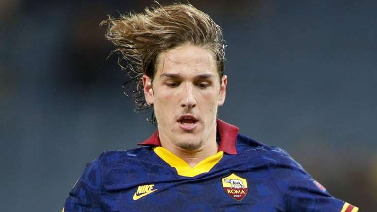 Nicolo Zaniolo was taken off on a cart in the first half of Roma's loss to Juve. GOAL