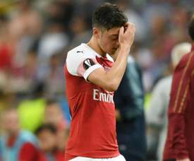 Ozil has polarised opinion among the club's supporters. GOAL