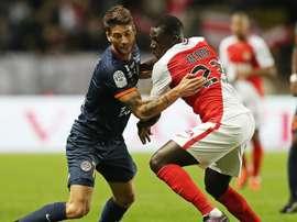 Paul Lasne à la lutte avec Benjamin Mendy lors du match entre Monaco et MHSC. Goal