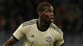 Pogba urged to get his head down by Manchester United legend Robson. GOAL