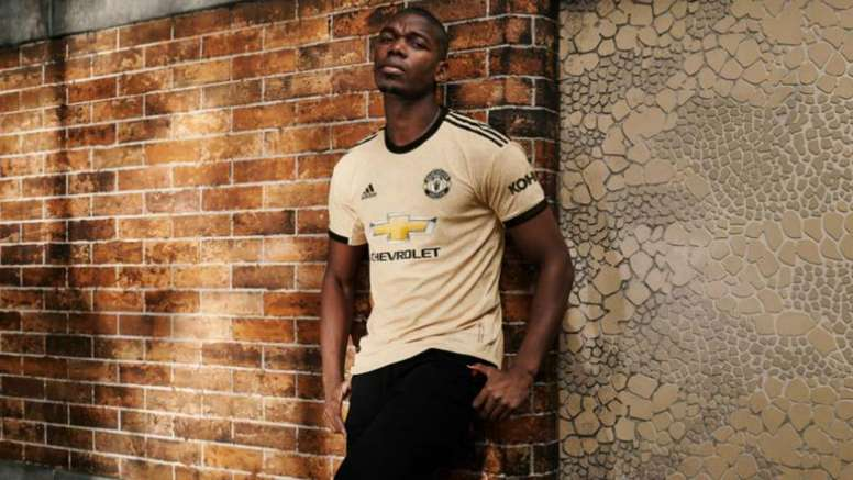 Pogba models the new United away kit despite wanting to leave club. GOAL