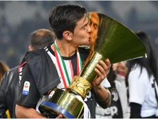 Paulo Dybala with the Serie A trophy. GOAL