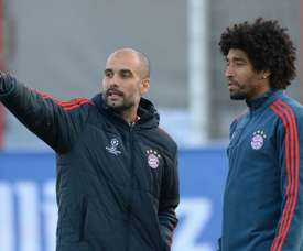 Pep Guardiola with Dante during a training session at Bayern Munich. Goal