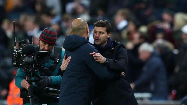 Pep Guardiola and Mauricio Pochettino embrace. GOAL