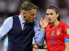 Phil Neville (L) is proud of his team and says they are closing the gap on the USA. GOAL