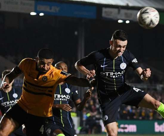 Foden battled through the playing conditions to net two for City. GOAL