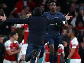 Paul Pogba was confronted by a pitch invader at the Emirates. GOAL