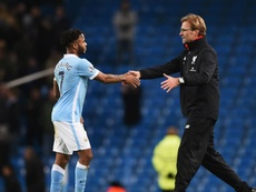 Raheem Sterling and Jurgen Klopp pictured at the Etihad. GOAL