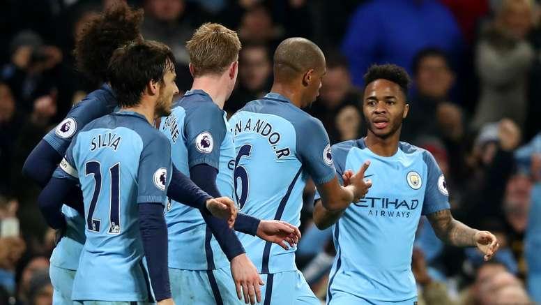 Raheem Sterling celebrates scoring the winner for Manchester City against Arsenal. Goal