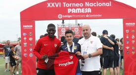 Reyes' son was presented with a Sevilla shirt at a football tournament.  GOAL