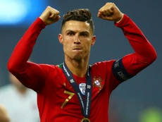 Cristiano Ronaldo with his Nations League medal. GOAL