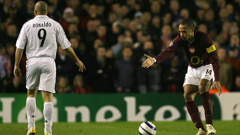 Henry (R) in action in the Champions League for Arsenal. Goal