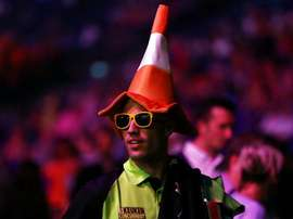 Van Persie wears traffic cone at Premier League Darts