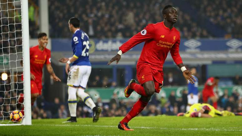 Sadio Mane celebrates his late winner in the Merseyside derby. Goal