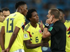 Colombian players surrounded the referee all night. GOAL
