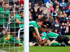 Lincoln City players celebrating their success. Goal