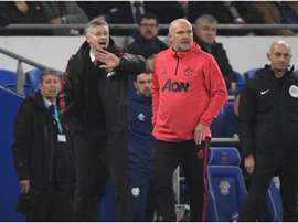 Mike Phelan hopes to continue in both roles. GOAL