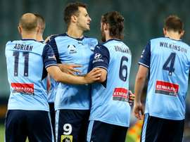 Sydney FC edged a five-goal thriller against Wellington Phoenix. GOAL