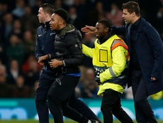 A fan invaded the pitch during their UCL win over Man City. GOAL