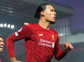 Van Dijk refuses to agree that title race is over. GOAL