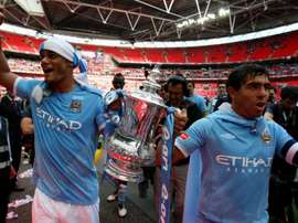Vincent Kompany holds the FA Cup with Carlos Tevez. GOAL