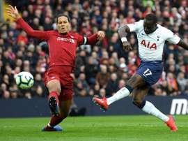 Virgil Van Dijk challenges Moussa Sissoko. GOAL